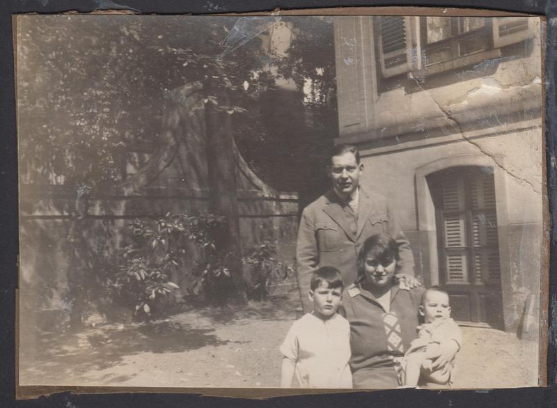 Herbert Kohn with his parents and brother in front of the family's apartment on Priest Strasse in Frankfurt, Germany, ca 1930.